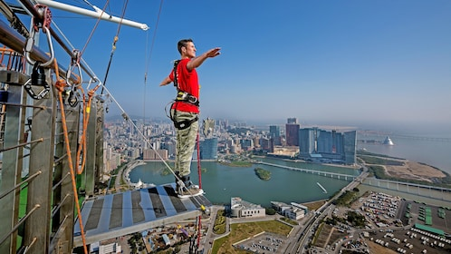 Man preparing to leap from 764 feet (233 m) off the top of Macau Tower