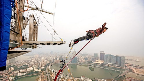 Young man leaping from 764 feet (233 m) off the top of Macau Towe