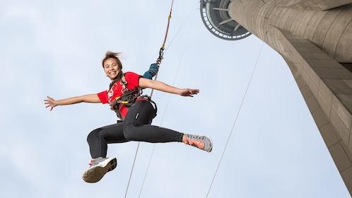 Girl leaping from 764-foot (233 m) Macau Tower