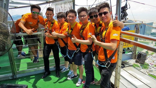 Group standing on top of the Macau Tower on the Skywalk at Macau Tower tower