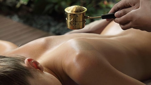 Woman on a day of pampering in luxurious spa & professional therapists