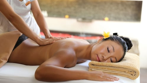 Woman receiving a relaxing massage at the Amala in Bali