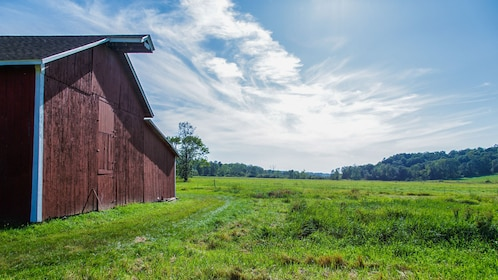Beautiful landscape view of area with barn house.