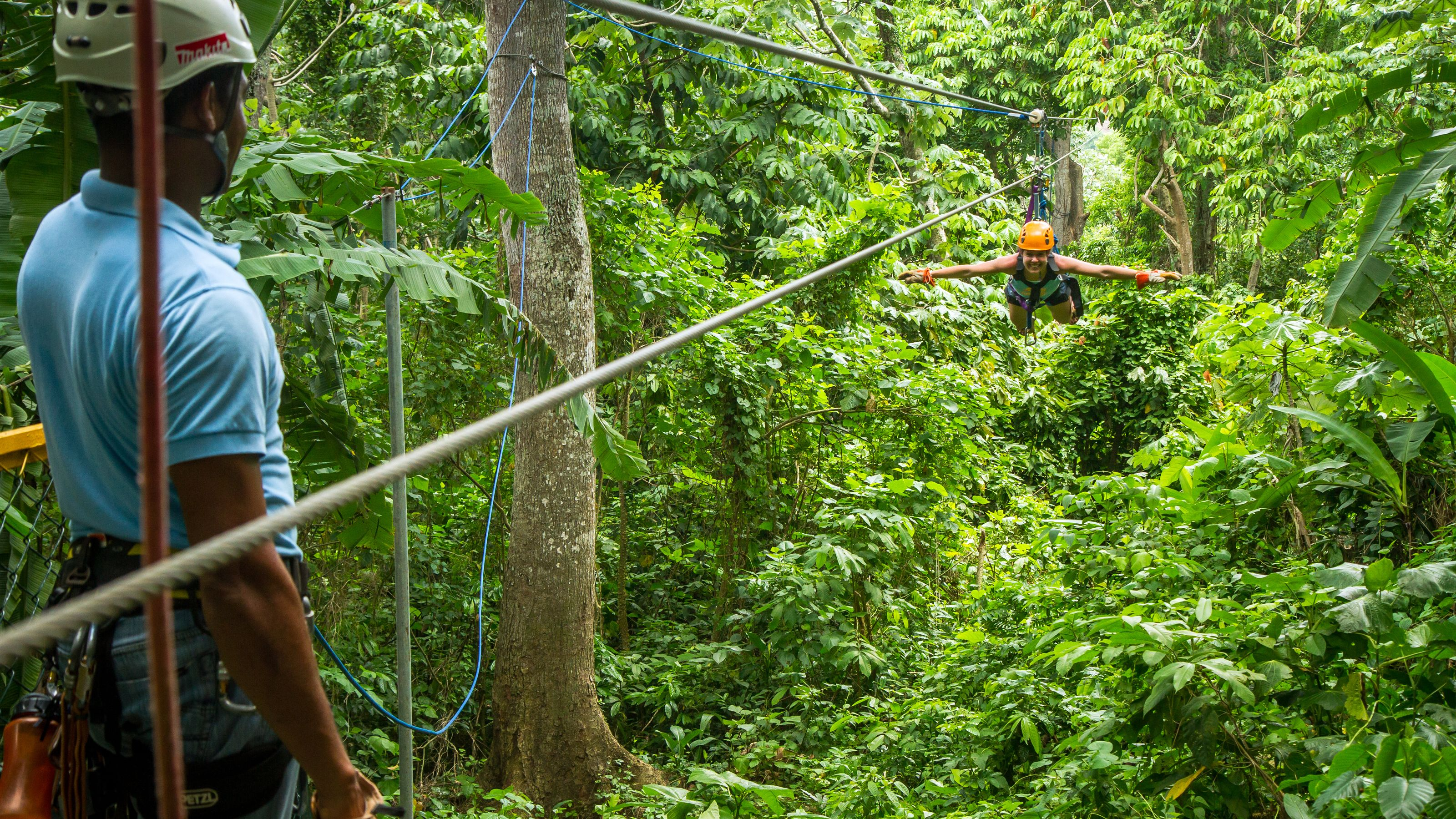 woman flying through trees in Punta Cana