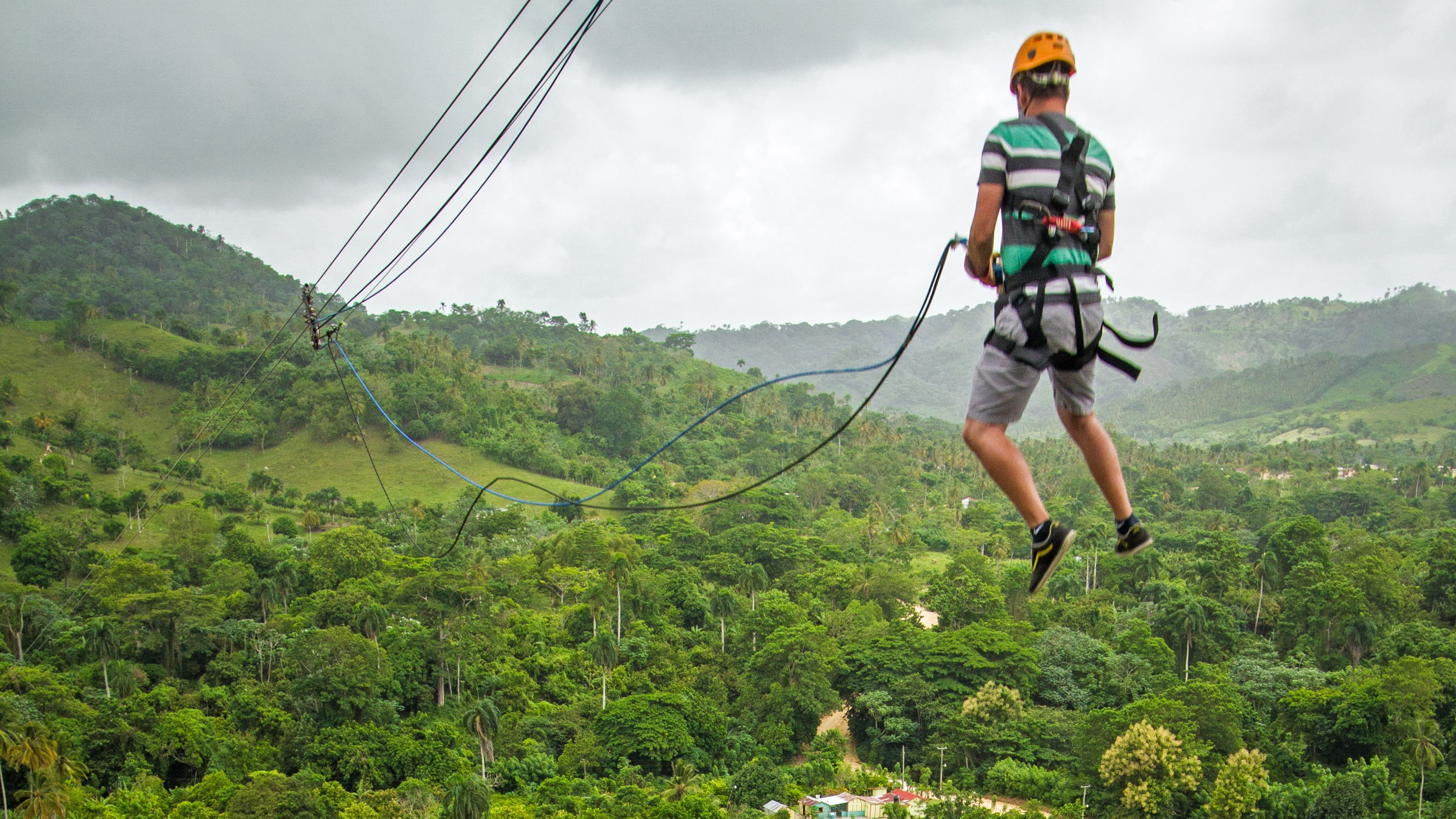 Man at top of swing in Punta Cana