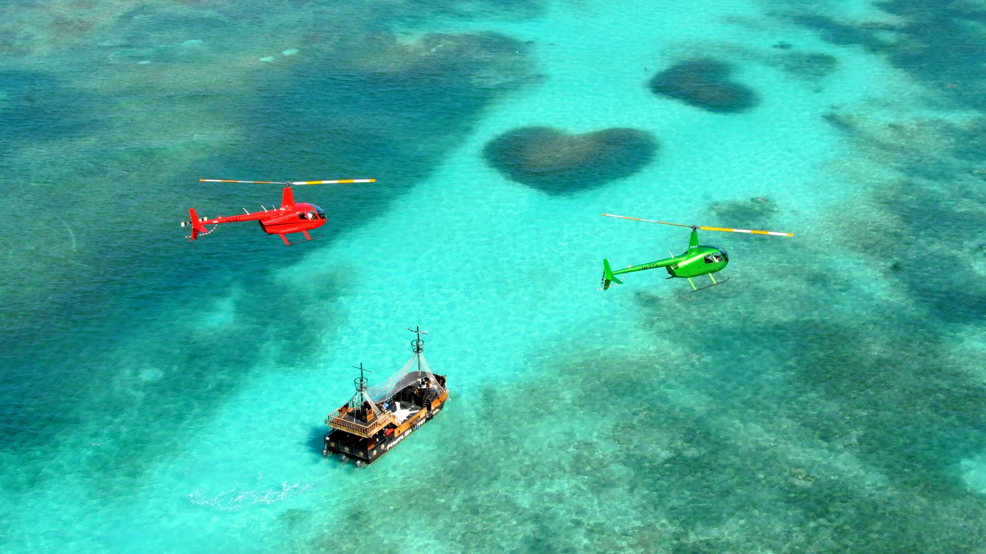 Helicopters over ocean and boat in Punta Cana