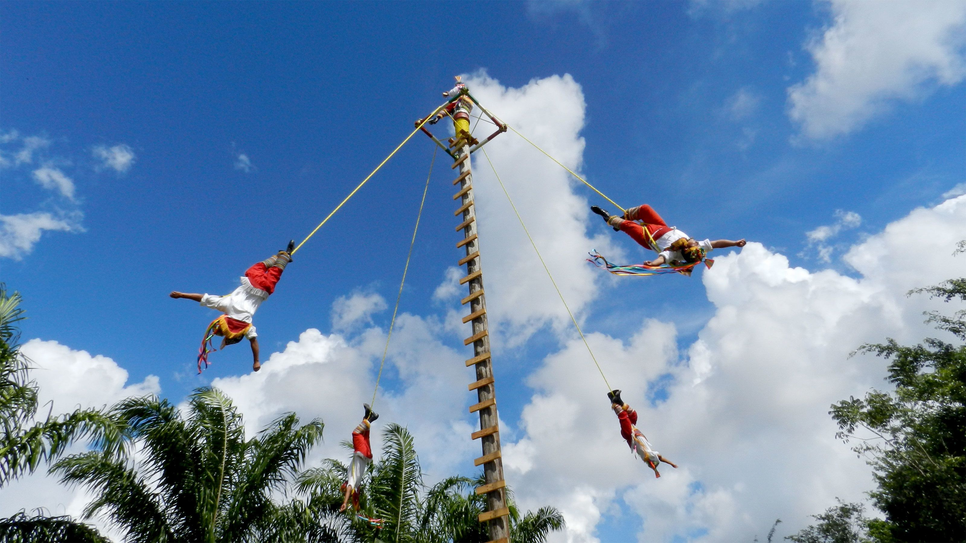 Three acrobats in Cozumel, Mexico
