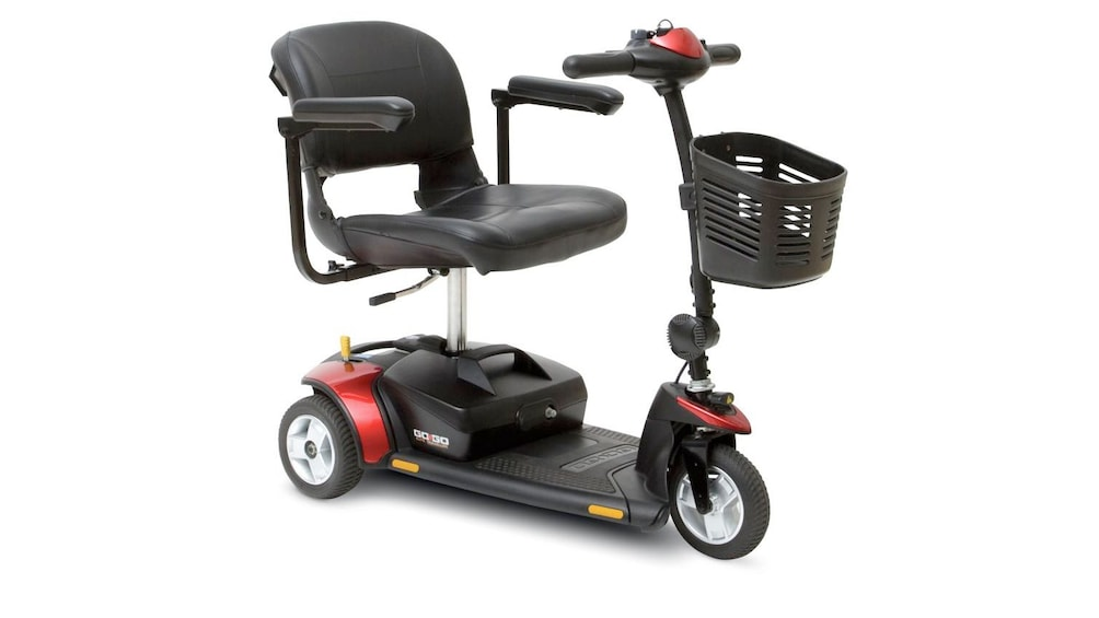 Show item 3 of 5. three wheeled red scooter at the rental store in Orlando