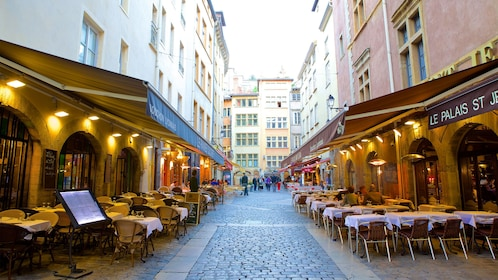 Cafes and outdoor seating along narrow pedestrian street in Paris