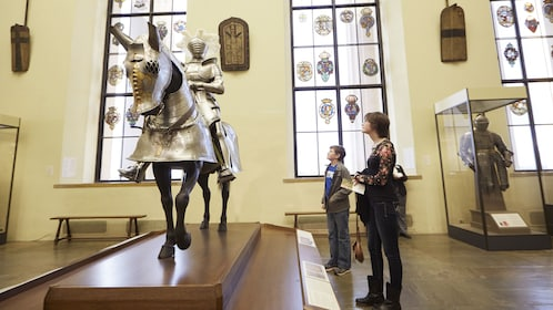Mother and son looking at horse and man in a suit of armor at the Philadelphia Museum of Art