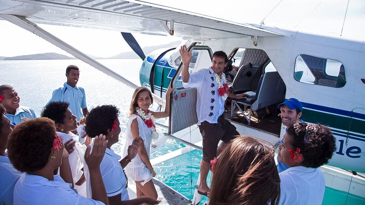 people boarding plane in fiji