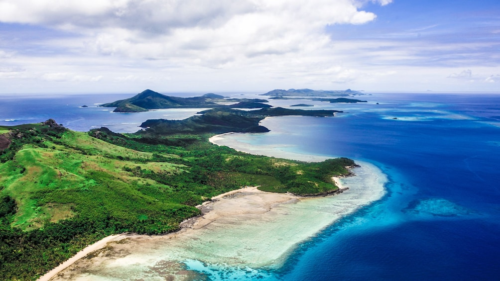 Show item 1 of 5. aerial view of island and beach in fiji