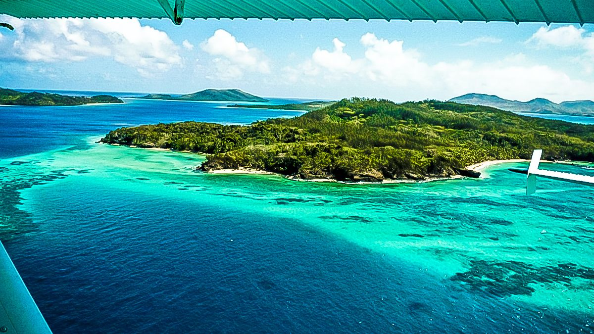 aerial view of island and beach in fiji