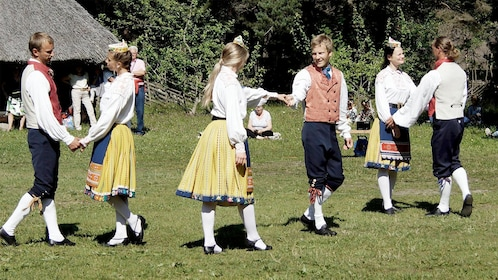 Locals dancing on the Tallinn Day Trip with Guided Walking Tour