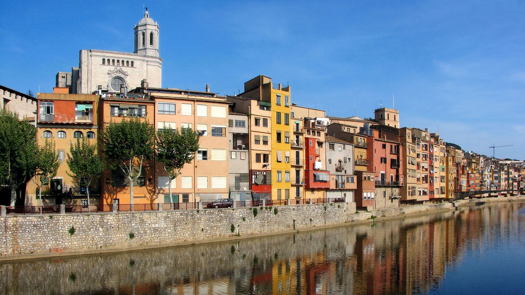 vibrant colored buildings along the water channel in Barcelona
