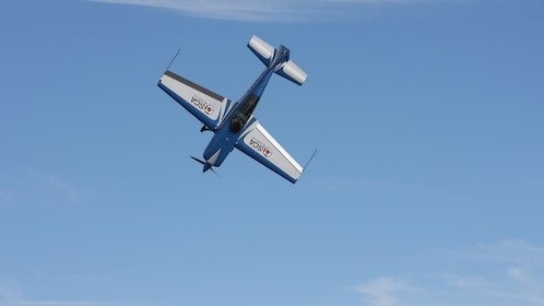 blue plane taking a nose dive in San Diego