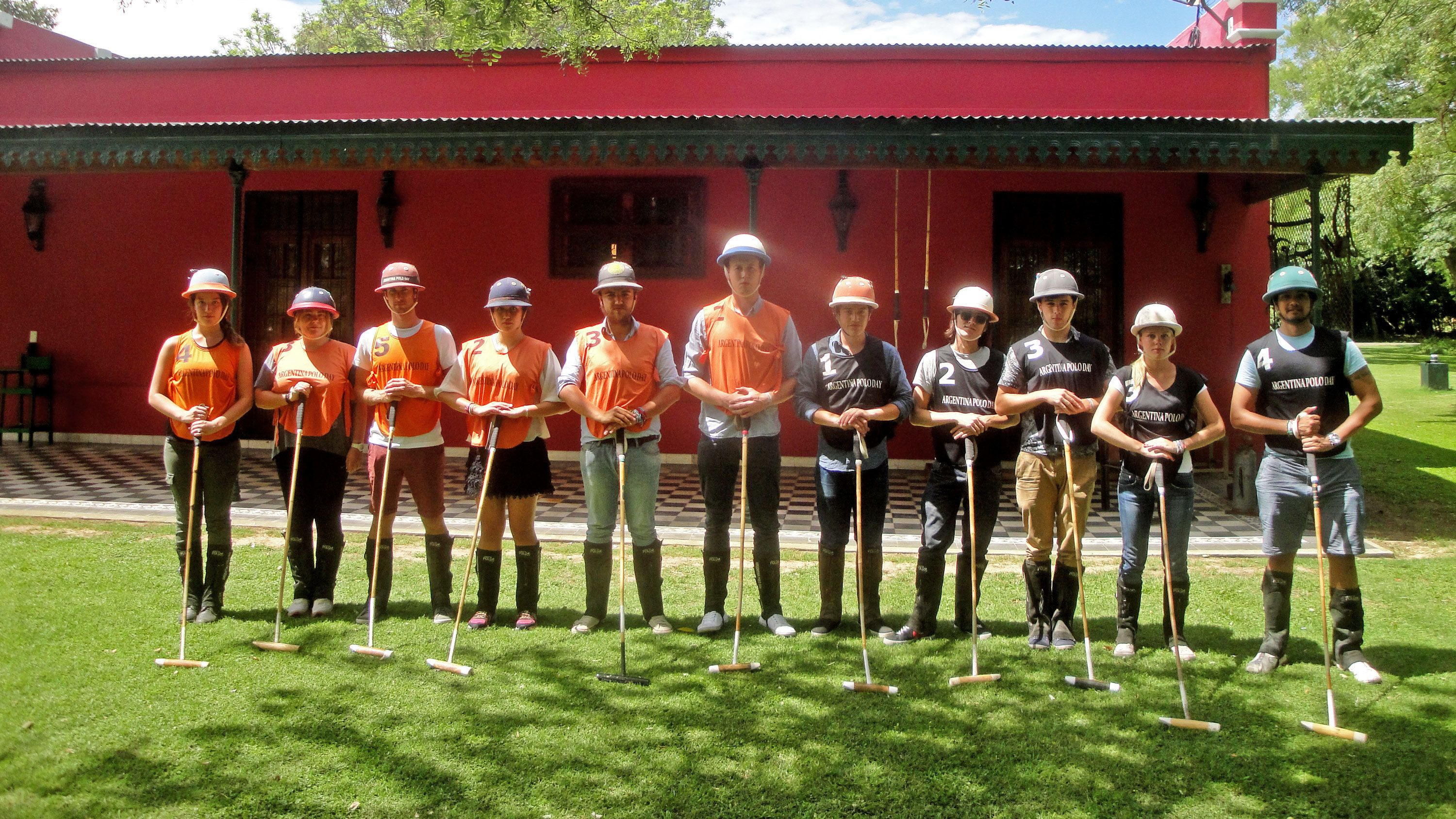 Tour group standing in a line on the polo tour in Argentina
