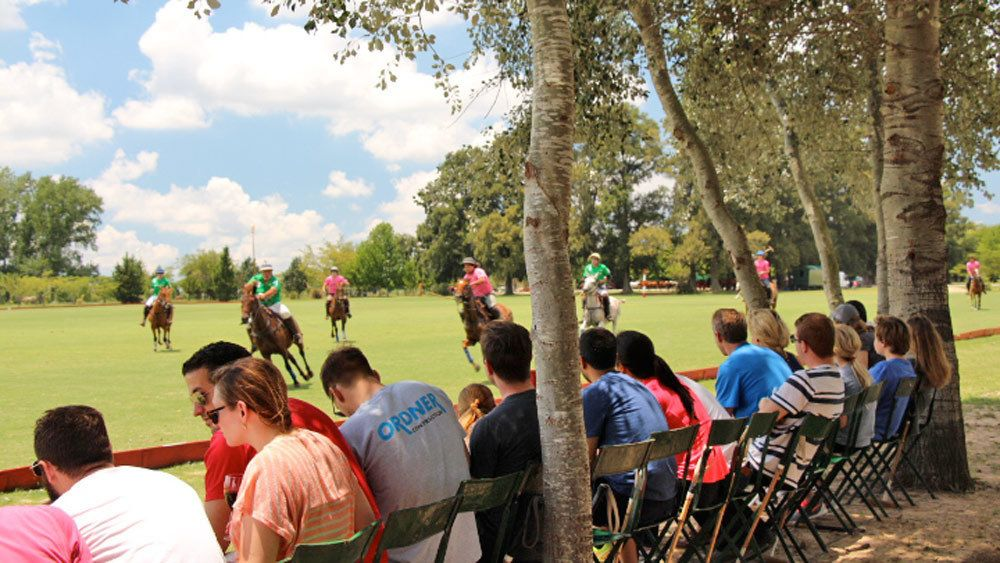 People watching a polo match in Argentina