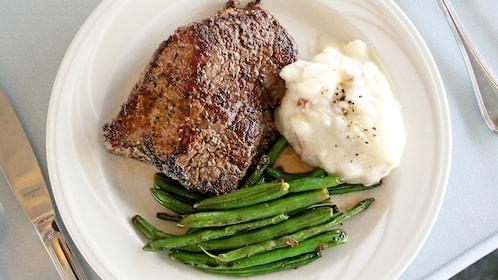 Steak, mashed potatoes and green beans as part of the Lake Mead dinner cruise