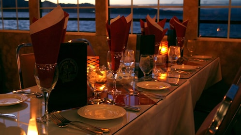 Dinner cruise tables set complete with candles