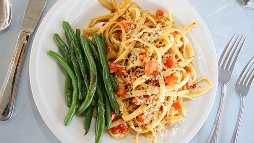 Pasta with a side of green beans as part of the dinner cruise