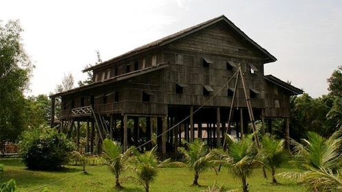 Calm view of a wooden house at the Sarawak Cultural Village in Malaysia