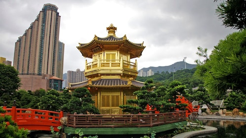 golden structure on a pagoda next to a pond in Hong Kong