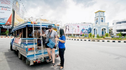 passengers exiting a small truck in Thailand
