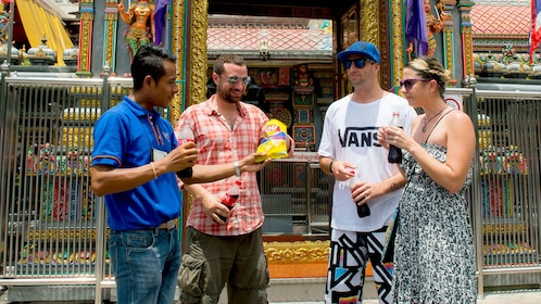 group trying Thai snacks in Thailand