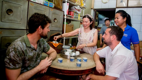 visitors learning about traditional teas in Thailand