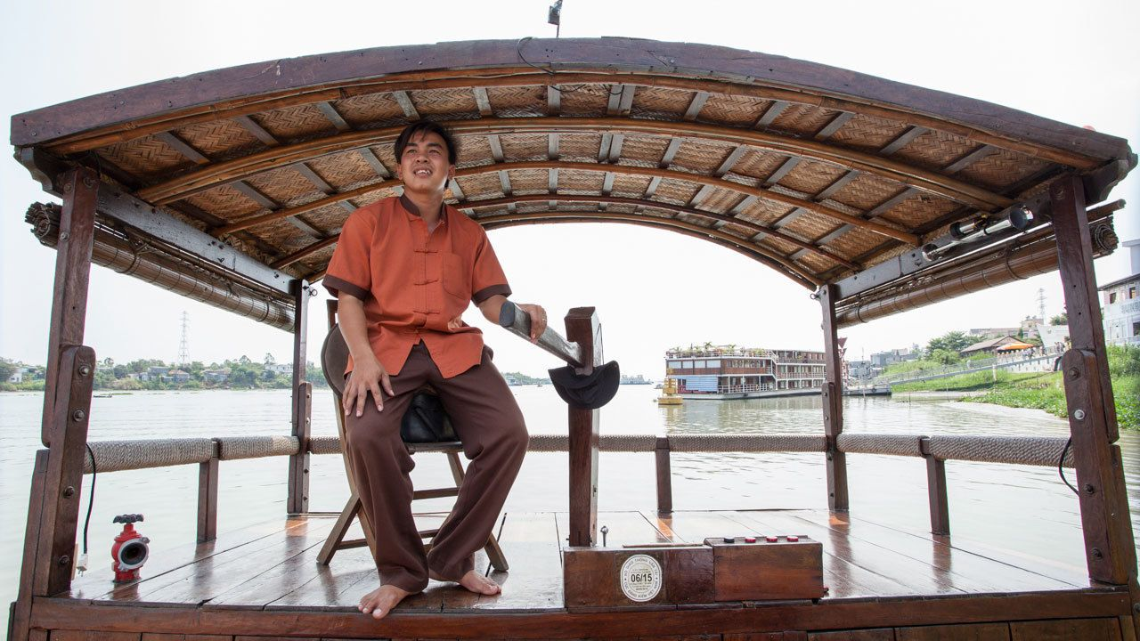 navigator on the deck of the Mekong Delta Le Jarai Cruise in Vietnam