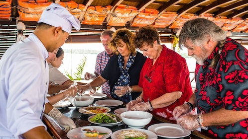 preparing food on the Mekong Delta Le Jarai Cruise in Vietnam