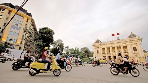 scooters and motorcycles on the road in Hanoi