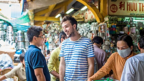 visiting the crowded street market in Saigon
