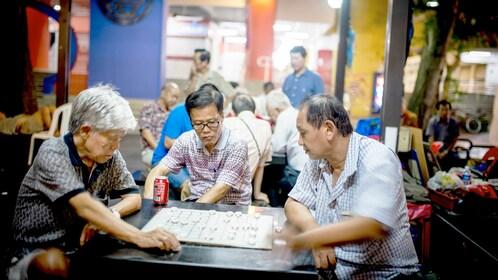 Three men play a game in Hong Kong