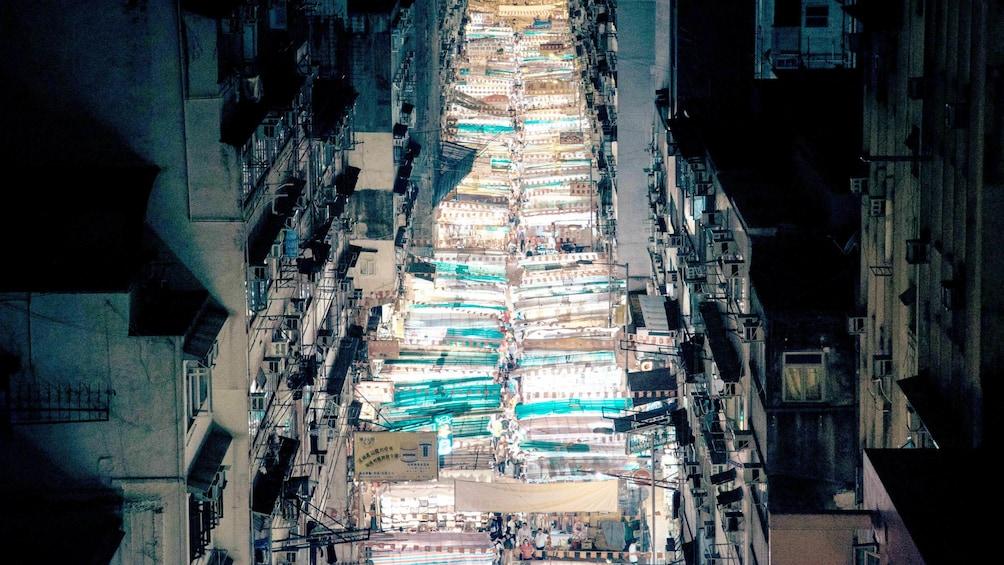 View of night market shining down street in Bali