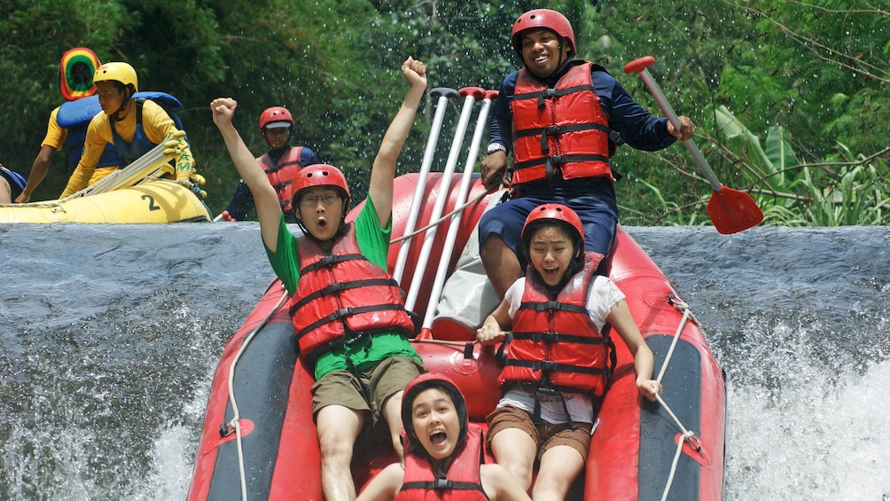 Show item 7 of 7. Tourists enjoying a white water rafting adventure in Bali