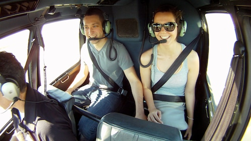 Couple takes helicopter tour