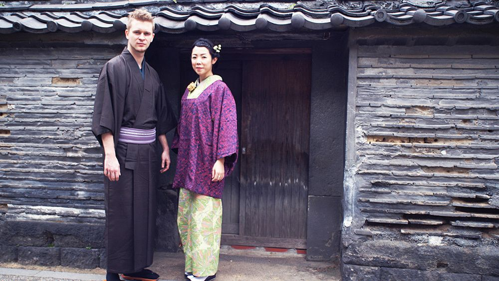 Man and woman pose in traditional Japanese costumes