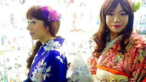 Two Japanese women in red and blue kimonos.