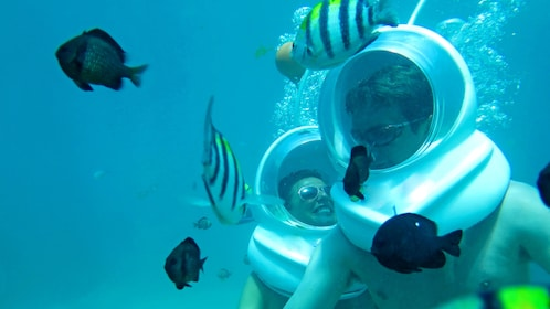 Couple enjoying an underwater adventure in BAli