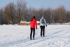 Cross-country skiing with a professional guide and a typical lunch