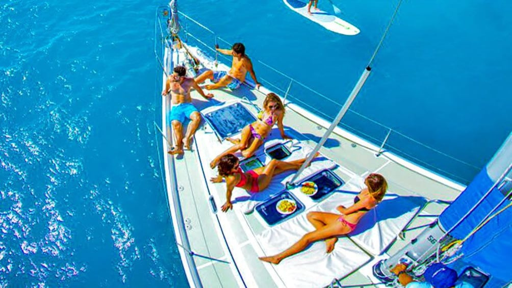 Show item 1 of 10. Lounging group on a sailboat in Los Cabos