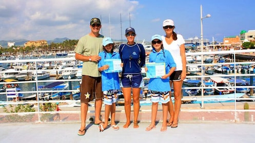 Family with training certificates in Los Cabos