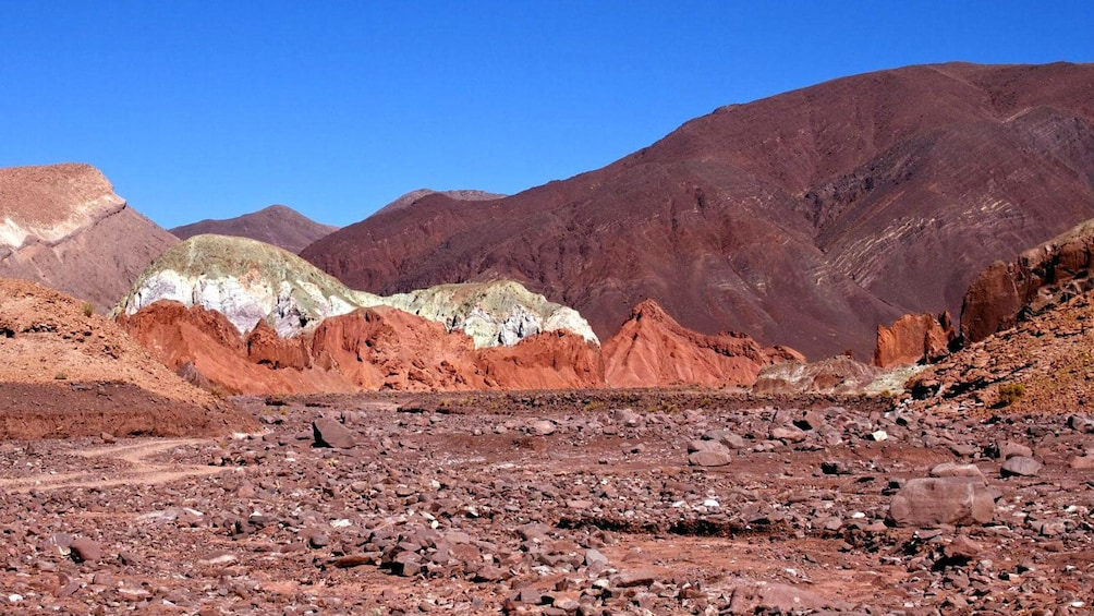 Show item 2 of 4. Various shades of red rock formations in Rainbow Valley