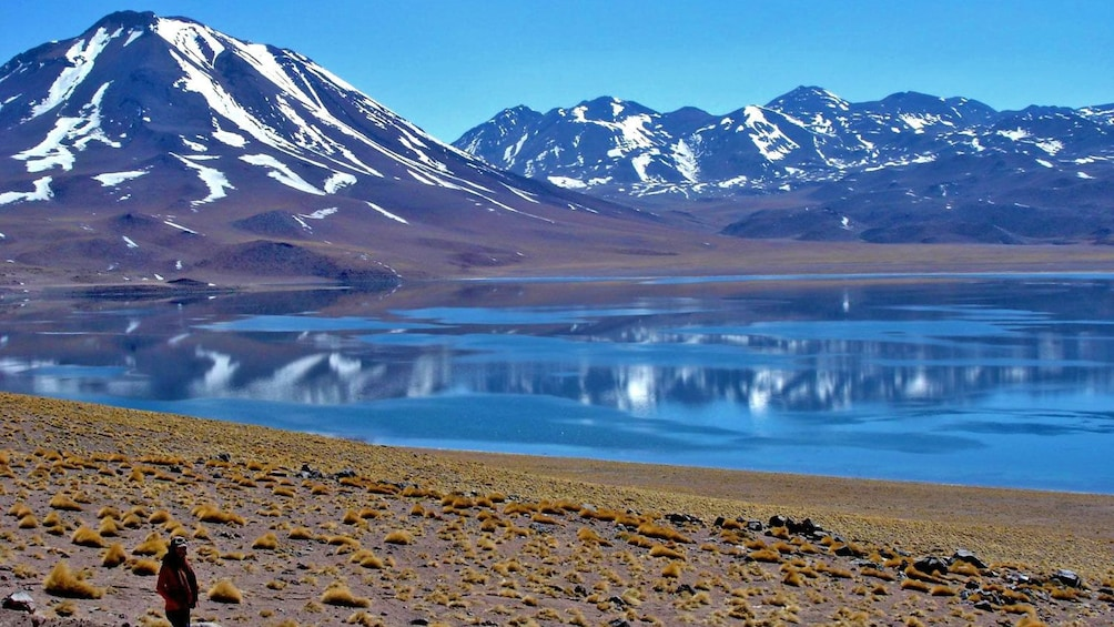 Show item 3 of 6. Calm lagoon at the base of snow-capped mountains in Chile