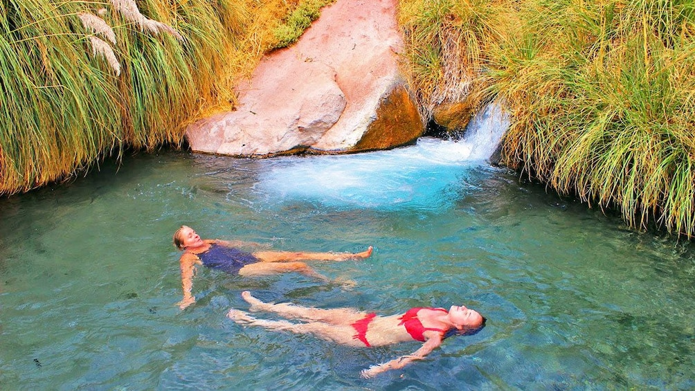 Show item 6 of 6. Pair of women relaxing in a hot spring in Chile