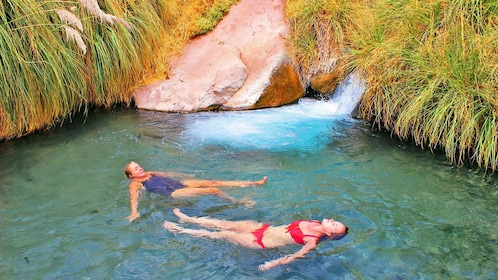 Pair of women relaxing in a hot spring in Chile