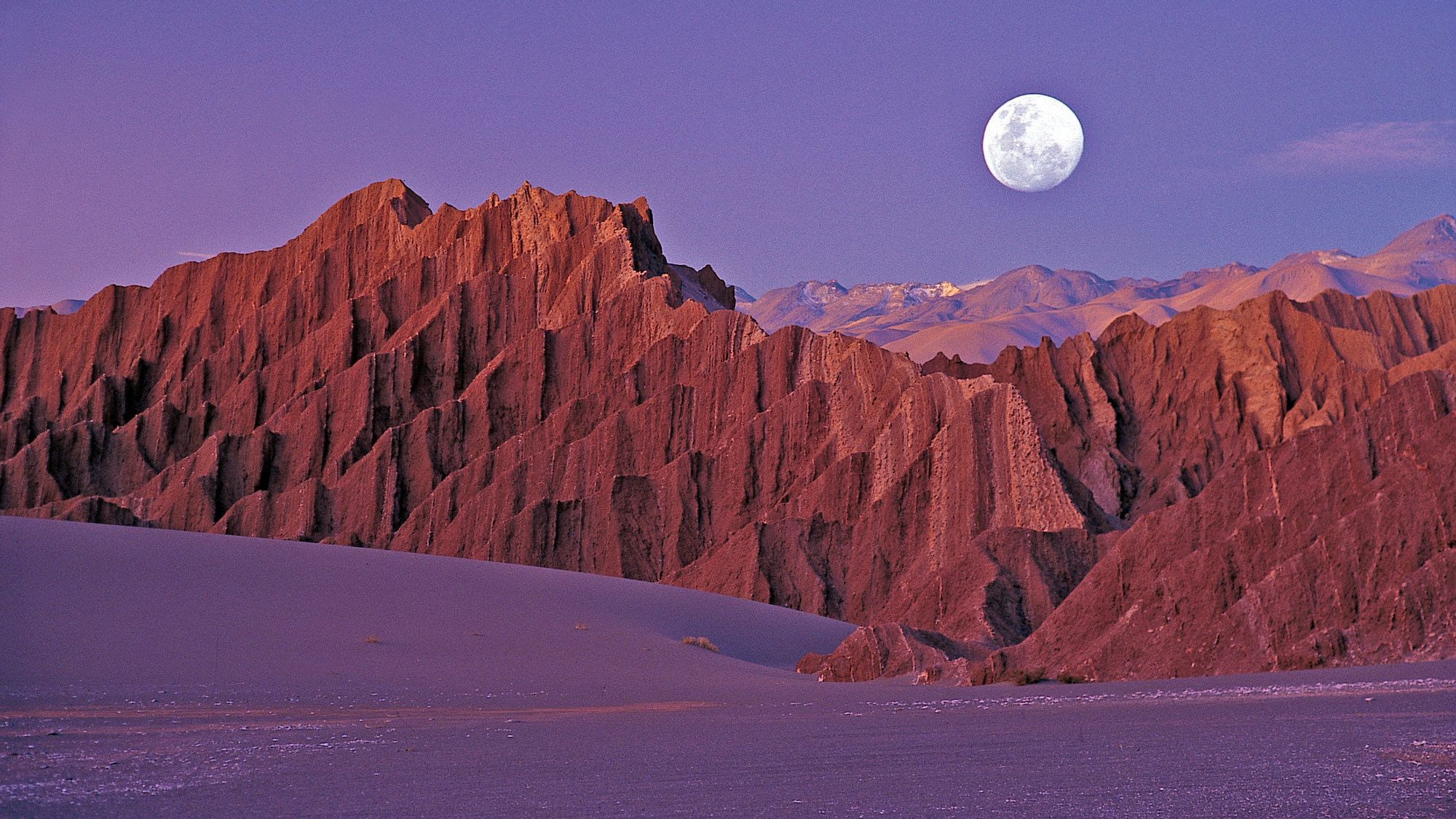 Moon rising over the mountains surrounding Moon Valley in Chile