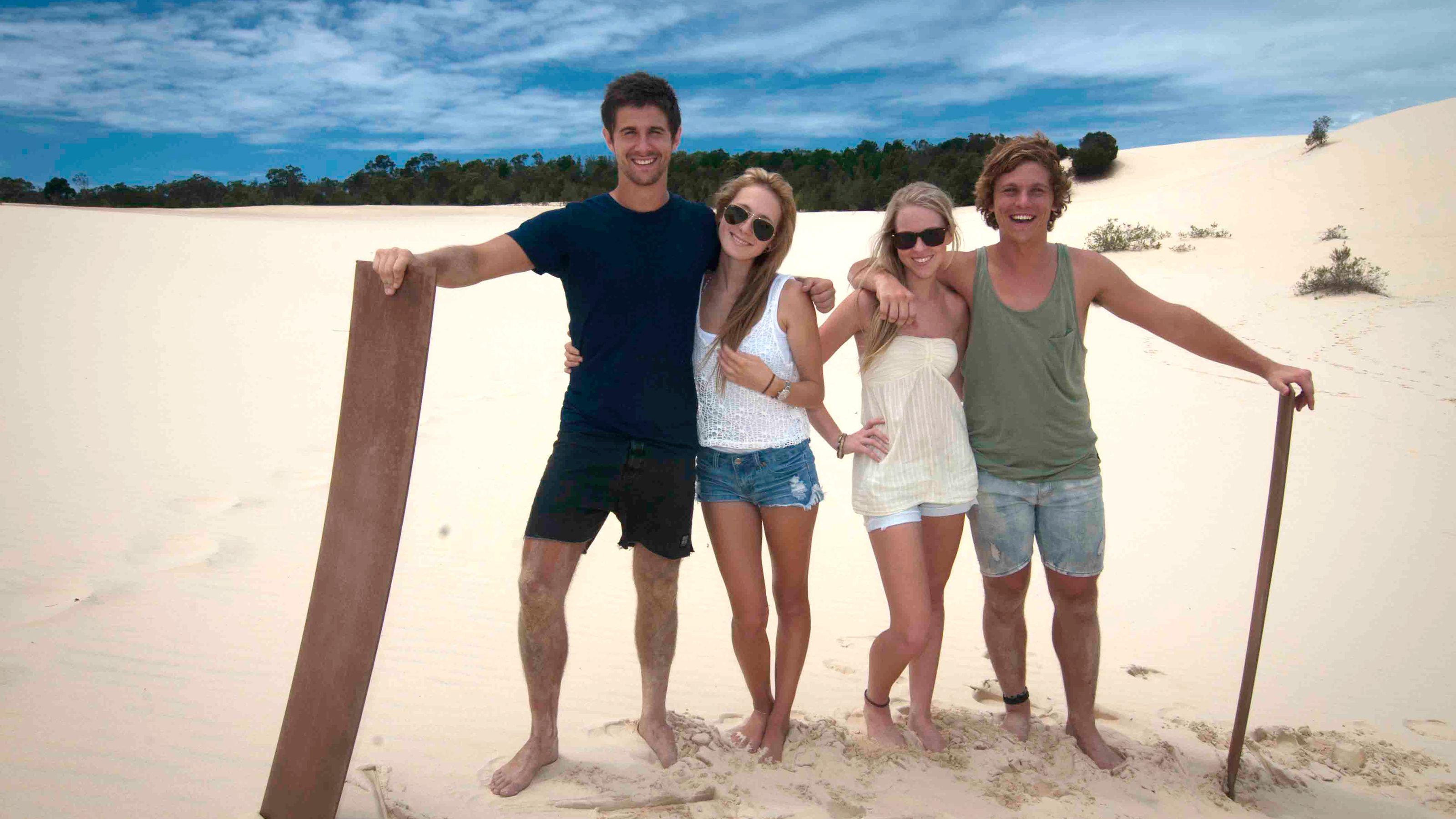 Two couples on sand dunes on Moreton Island